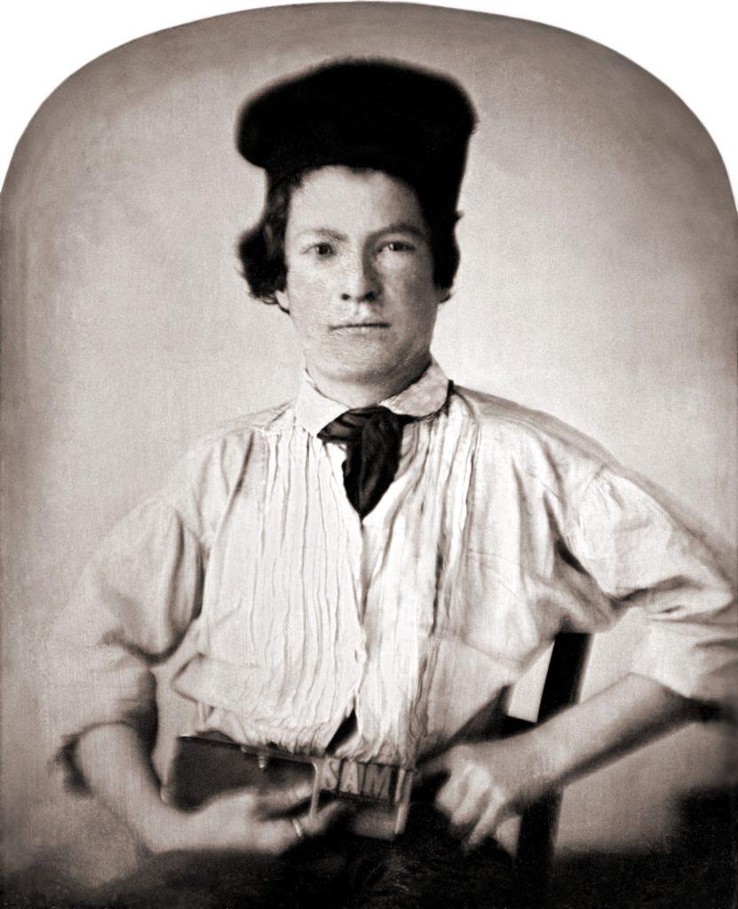 Портрет Сэмюэля Клеменса (15 лет) в юности, держащего печатную палку печатника с буквами SAM.